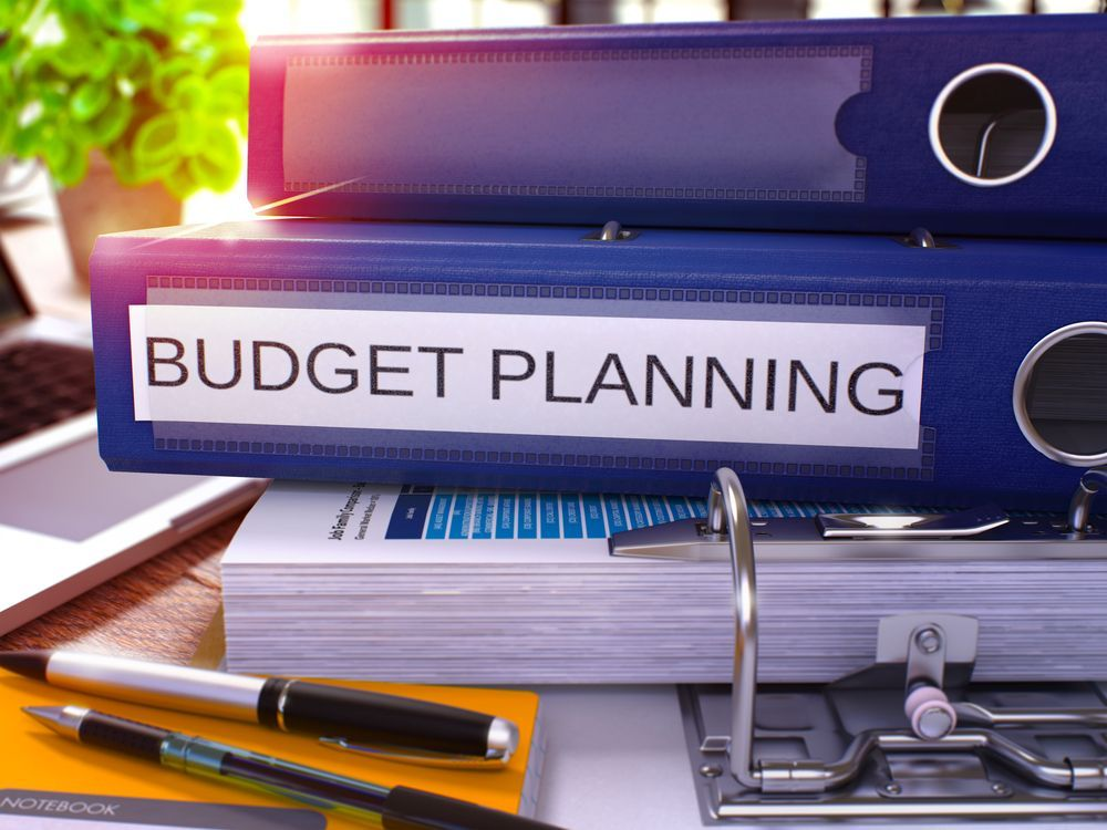 School Blog: Blue Ring Binder with Budget Planning on It