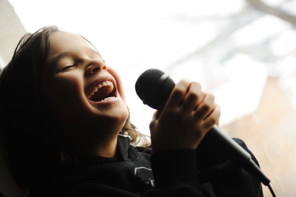 Voice - Kid singing song with microphone