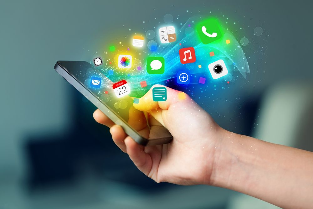 Church Social Media Policy Blog: Hand holding smartphone with app icons
