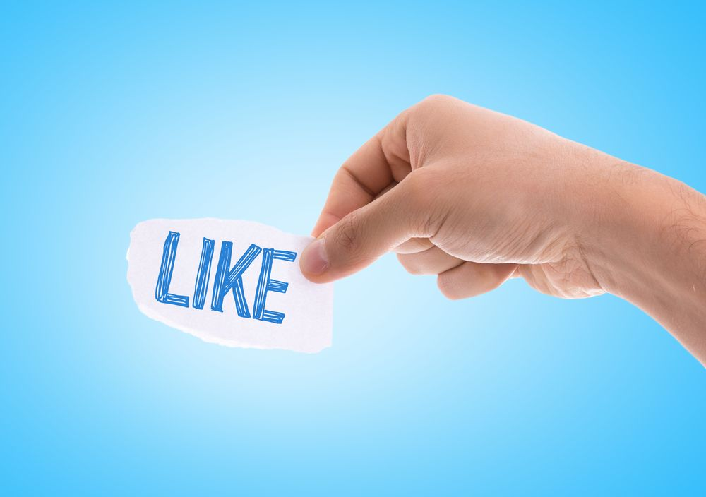 How to Create a Church Facebook Page - Hand Holding a Paper with Like