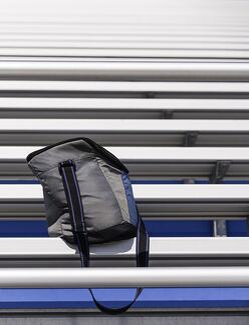 School Spirit Wear Fundraisers - bag on a bottom level of bleachers