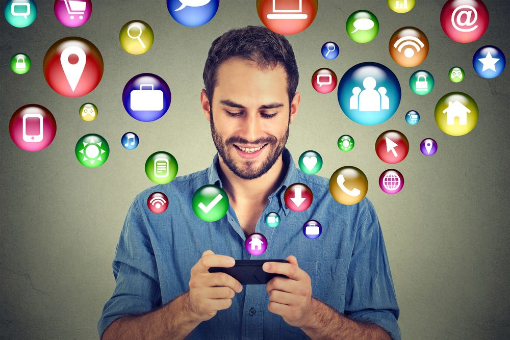 Church Social Media Strategy Blog - Guy with Phone & Icon Bubbles
