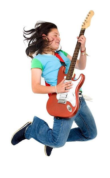 Girl with Guitar - Music & Movement Benefits Blog
