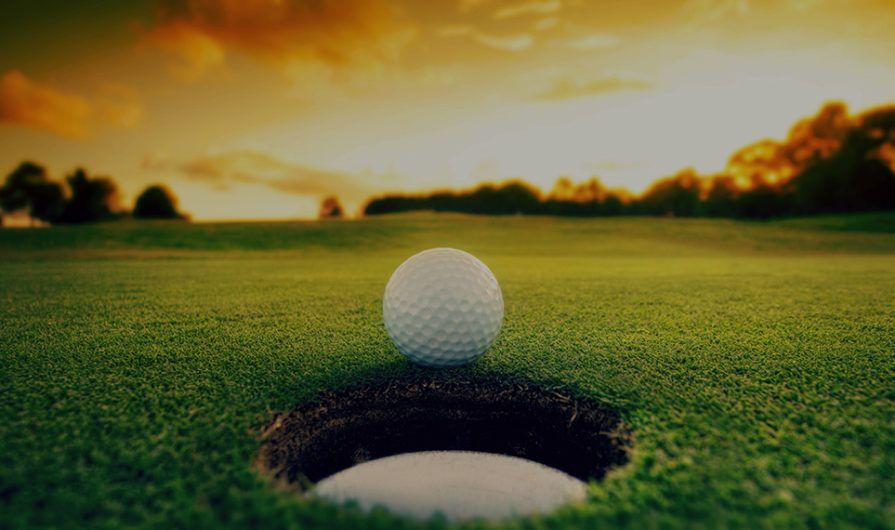 Golf Ball Just Above a Hole
