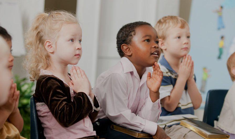 Row of Little Kids Praying