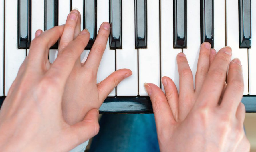 Overlapping Hands on Keyboard-Theology of Stewardship