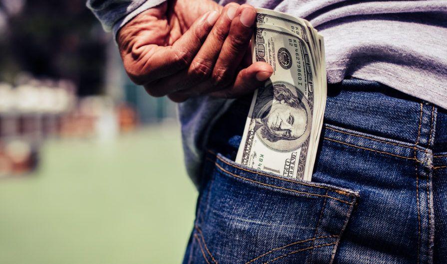 Hundred Dollar Bills in Man's Back Pocket