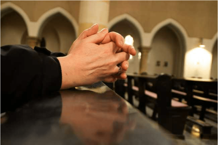 Church Change Management Blog - Folded Hands Praying at Sanctuary